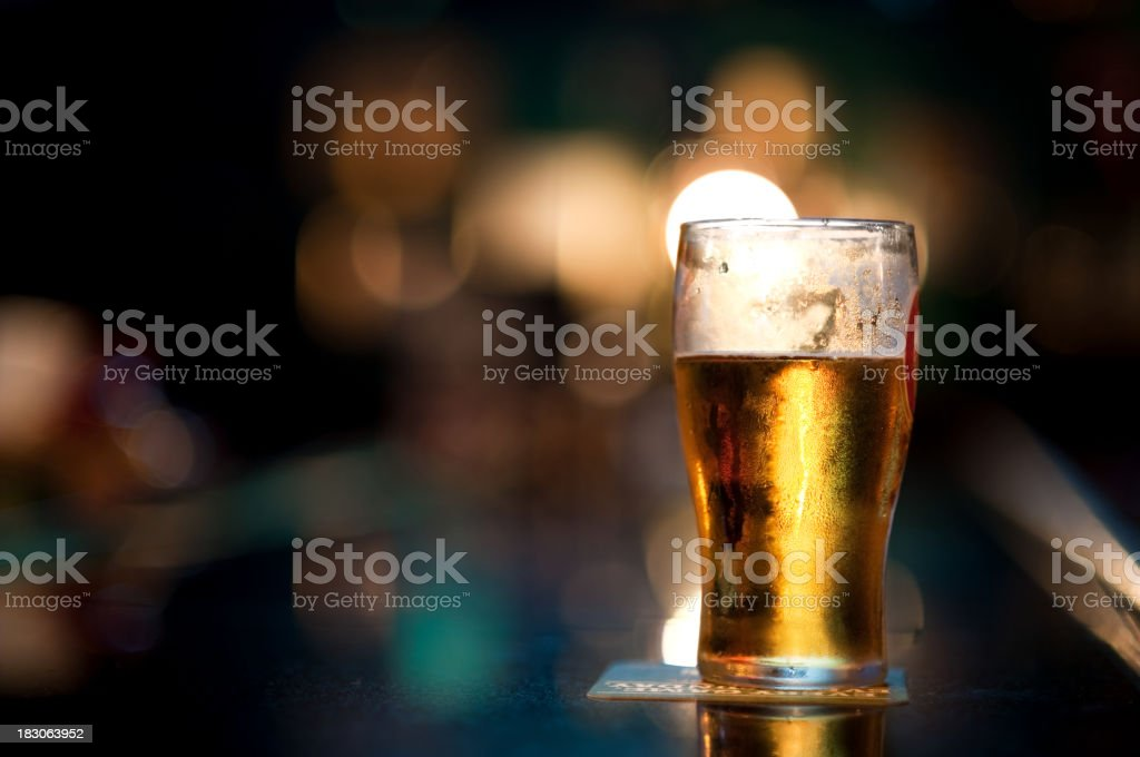 Pint of Beer on Bar stock photo