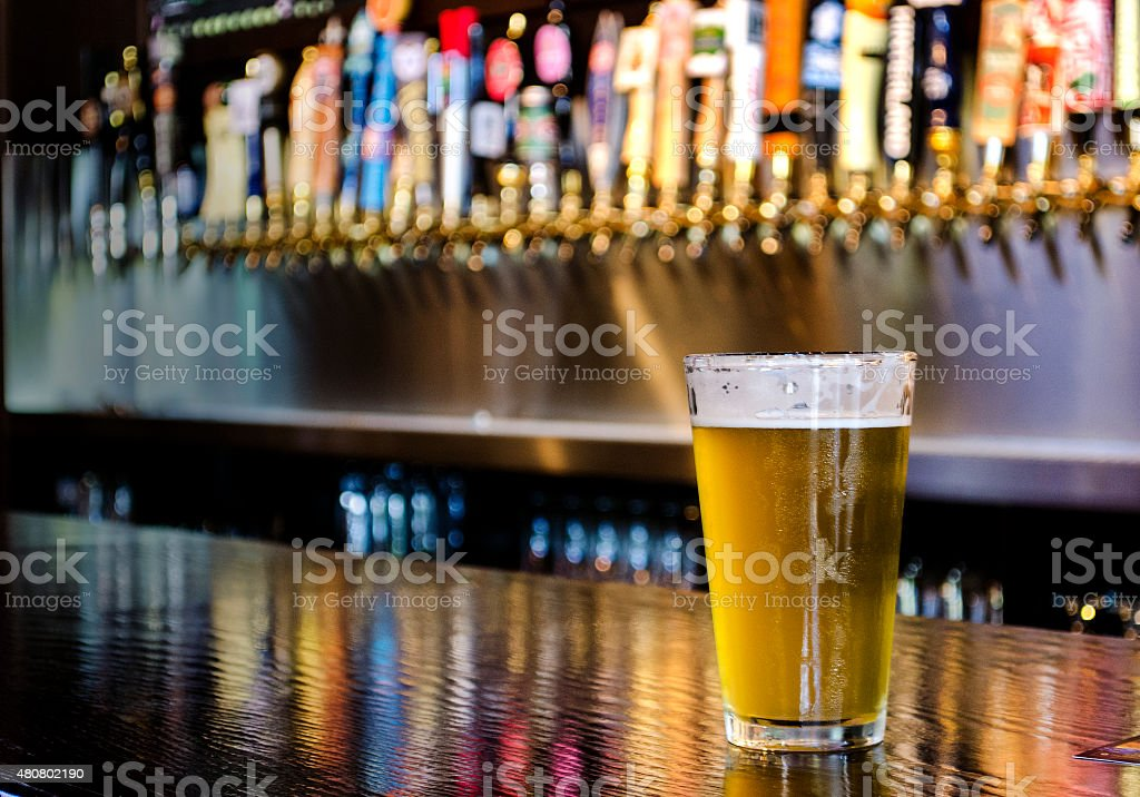 Pint of Beer on the Bar stock photo