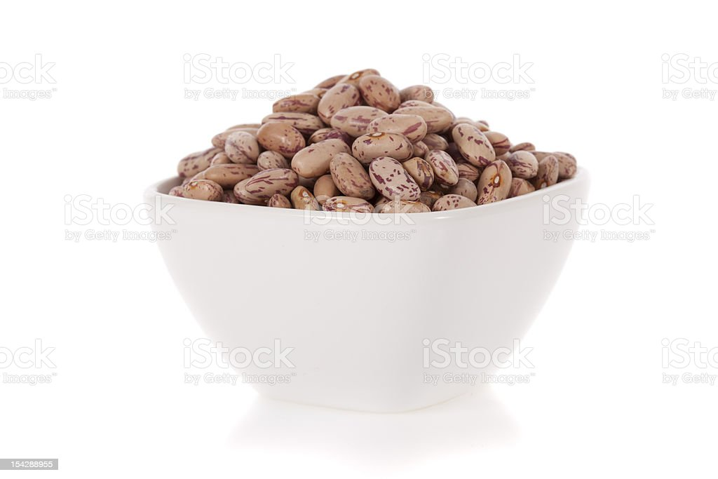 Pinto beans in a bowl isolated on white background stock photo