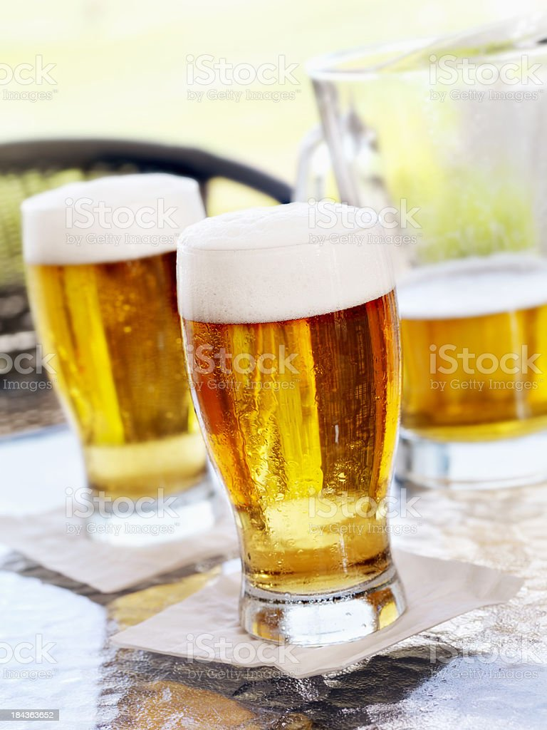 Pints of Beer on an Outdoor Patio stock photo