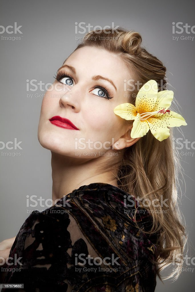 Pin-up girl: beautiful blond sexy woman with retro hairstyle royalty-free stock photo