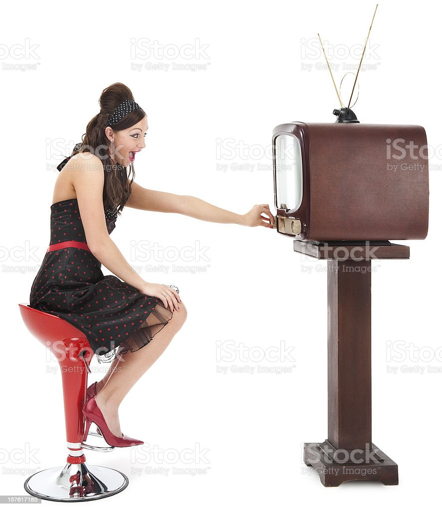Pin-up Girl Changing the Channel royalty-free stock photo