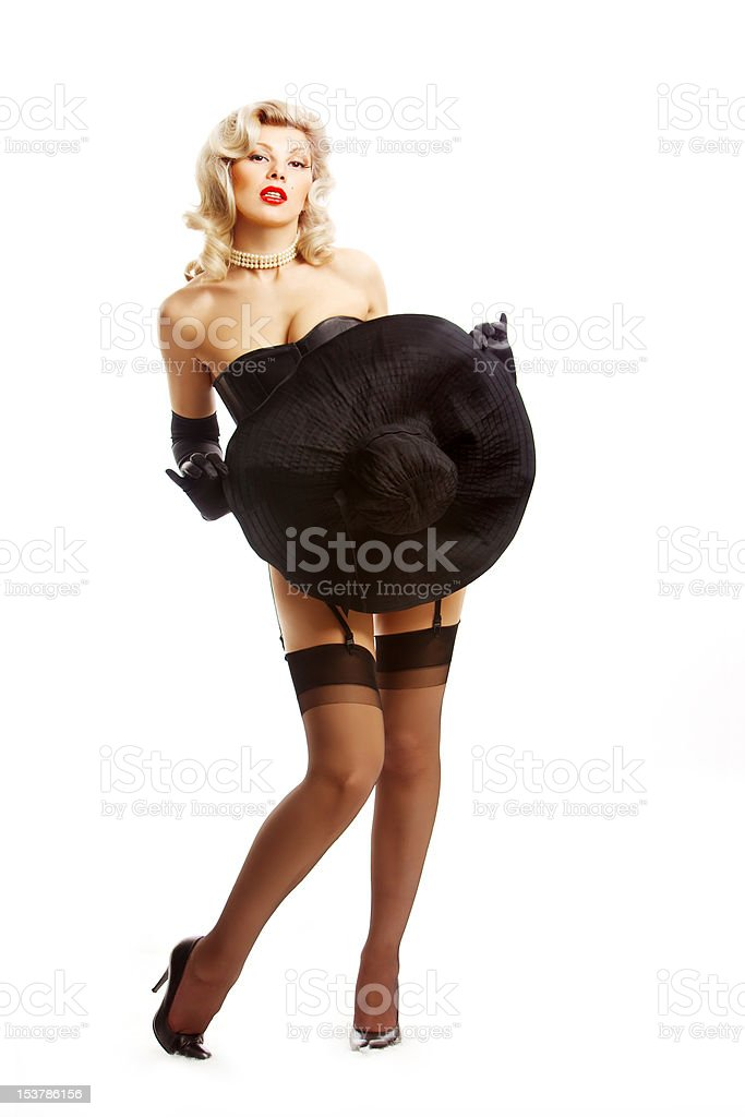 Pin-up girl hiding with a hut stock photo