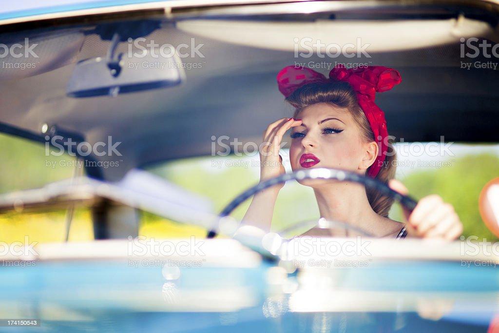 Pin-up girl in car stock photo