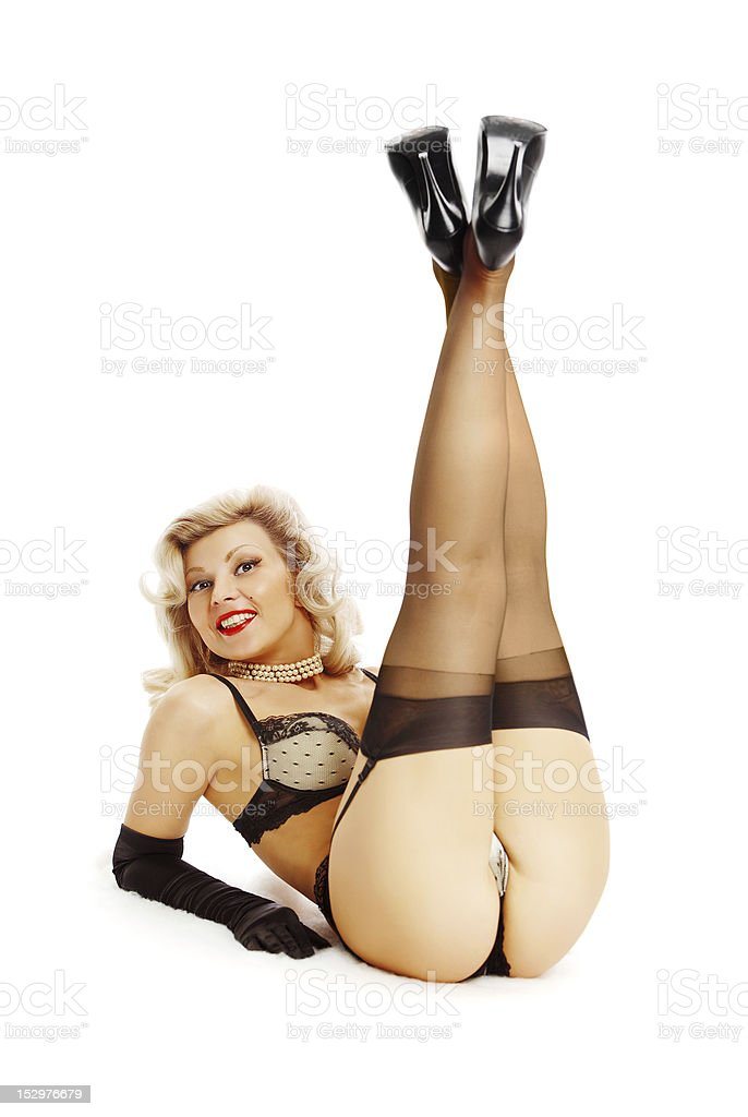 Pin-up girl liyng on the floor stock photo