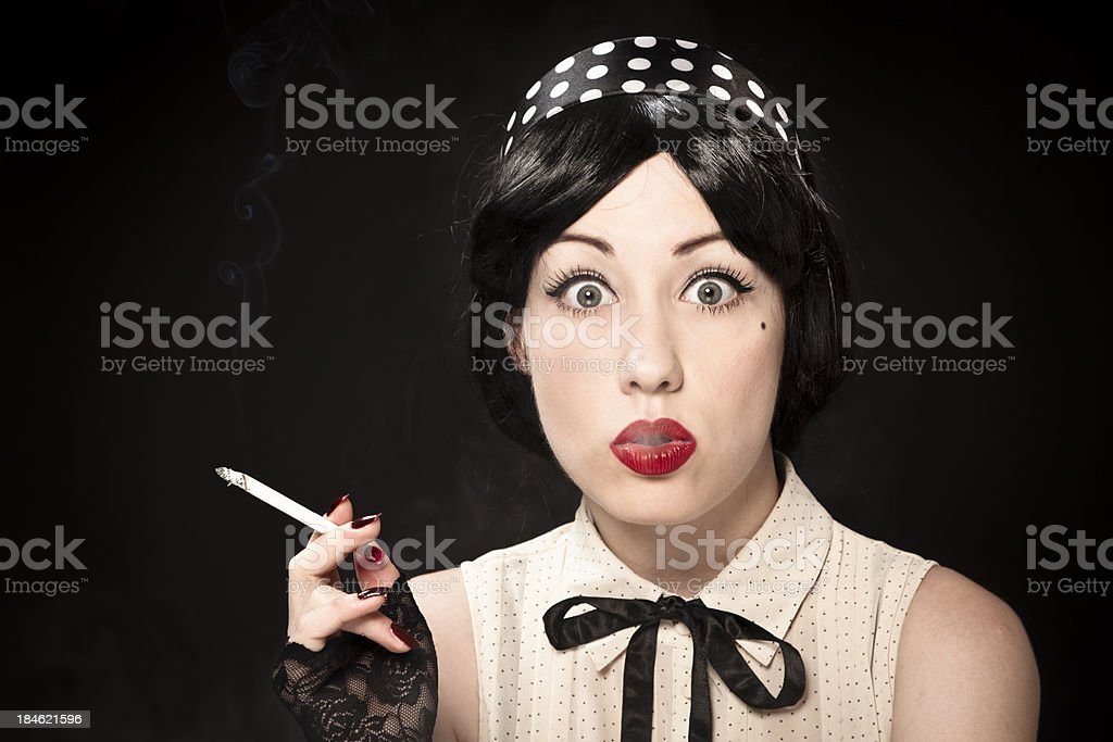 Pin-up girl smoking a cigarette royalty-free stock photo