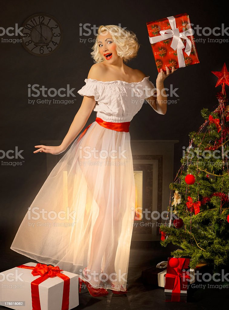 Pin-up girl with a gift royalty-free stock photo