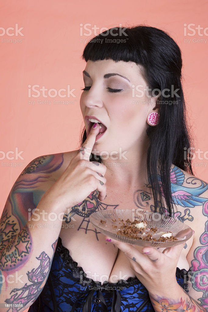 Pinup girl with eyes closed and mouth open, liccking finger. royalty-free stock photo