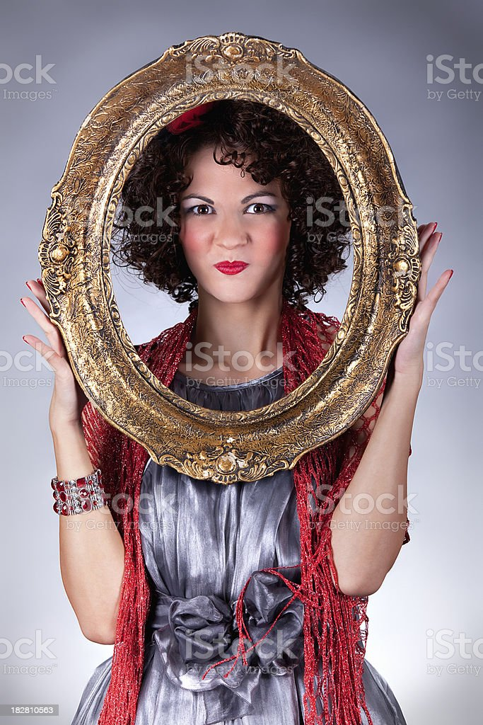 Pinup girl with golden frame stock photo