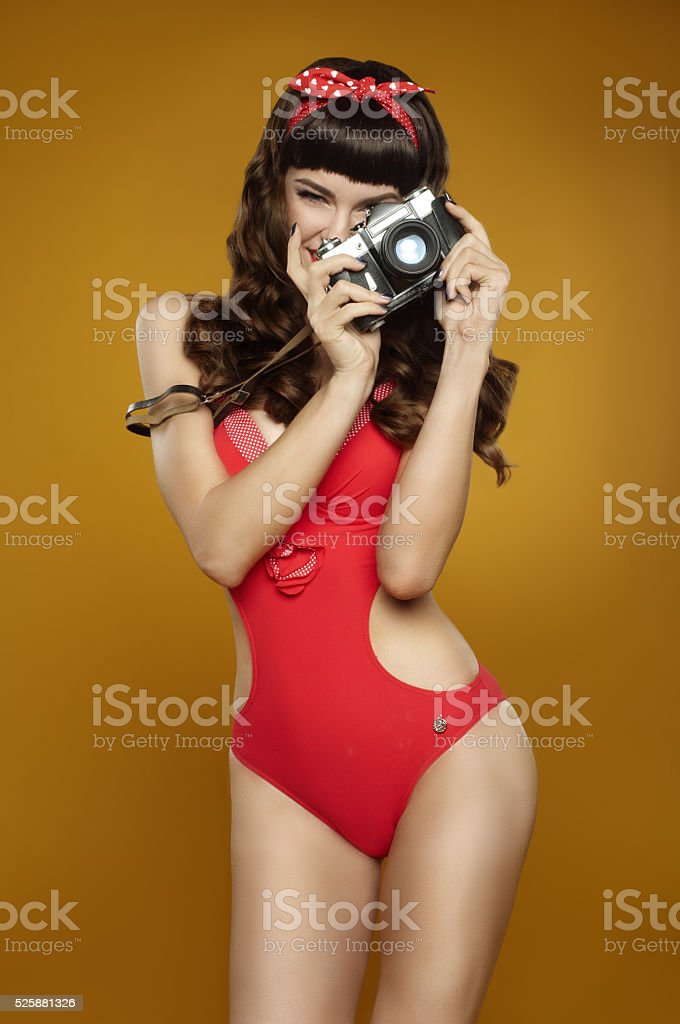 pin-up girl with retro camera stock photo