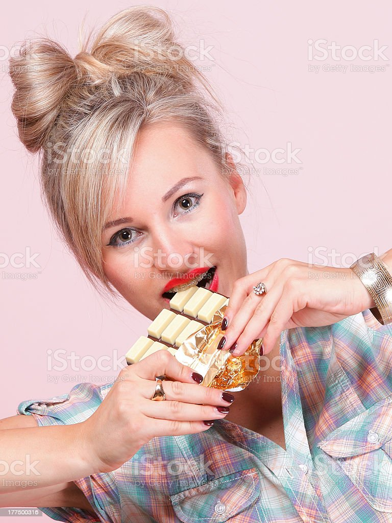 pinup girl Woman eating chocolate portrait royalty-free stock photo
