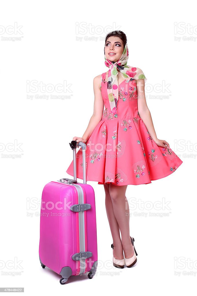 PinUp sexy girl with pink suitcase. royalty-free stock photo