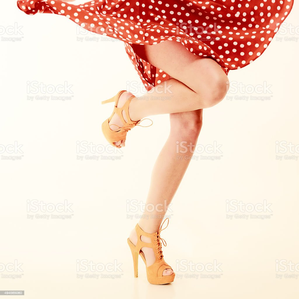 Pinup style. Sexy female legs in dance. stock photo