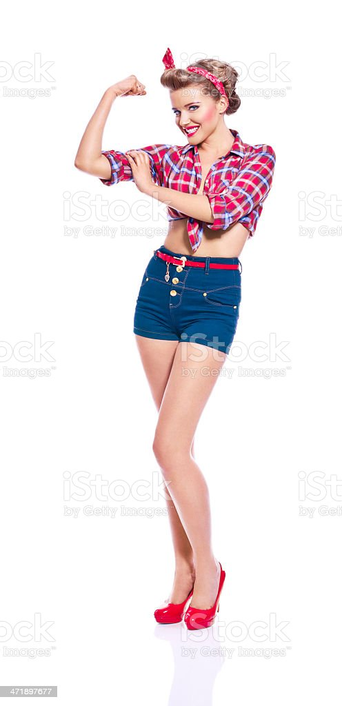 Pin-up style woman flexing her arm royalty-free stock photo