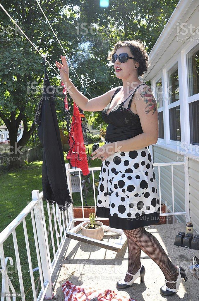 Pin-up Woman Smoking and Laundry royalty-free stock photo