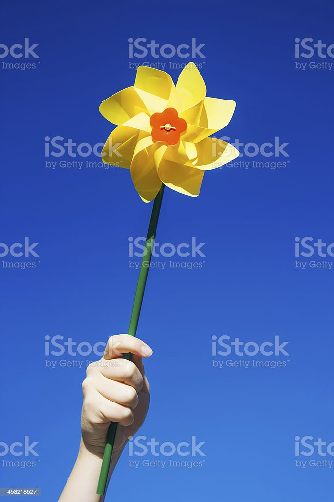Pinwheel in young girl's hand royalty-free stock photo