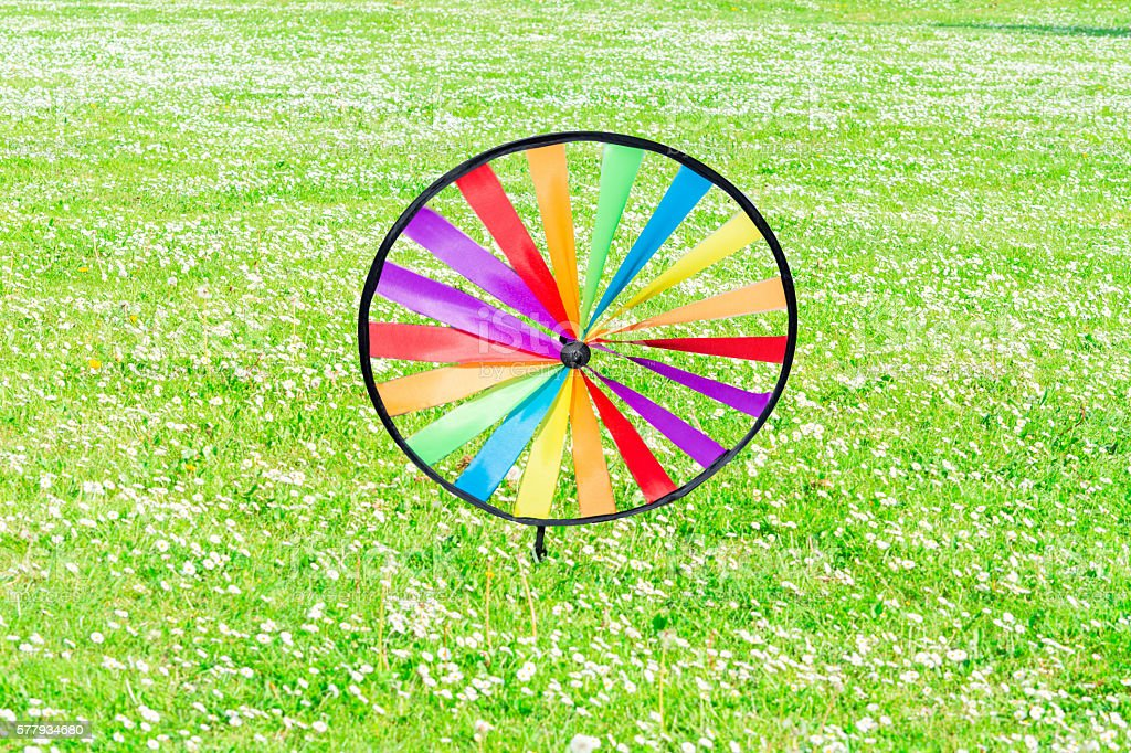 Pinwheel on a flower meadow. stock photo