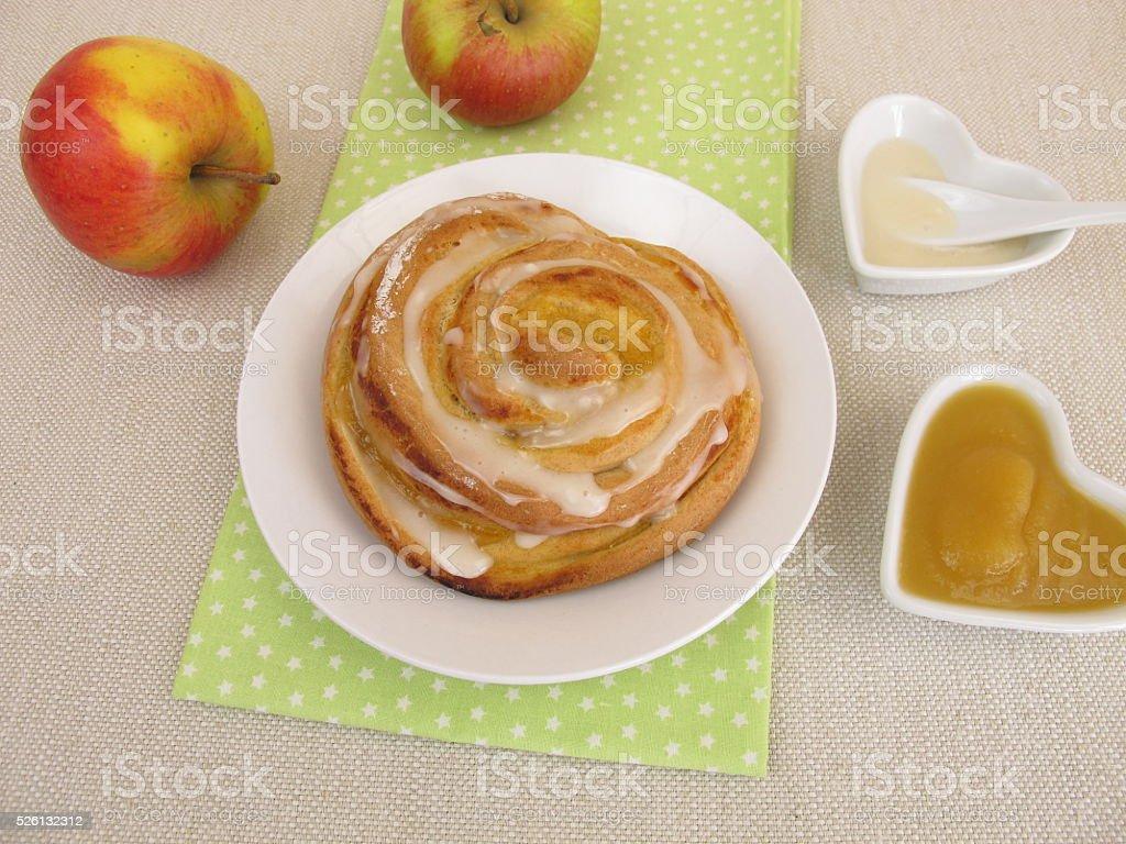 Pinwheel with apple sauce and sugar icing stock photo