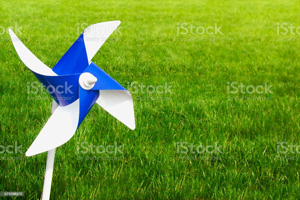 Pinwheel with grass stock photo