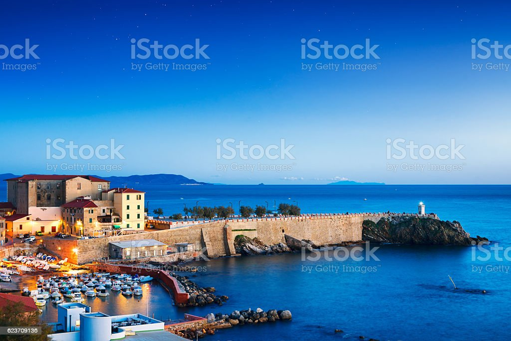 Piombino old town twilight panoramic view on piazza bovio lighth stock photo