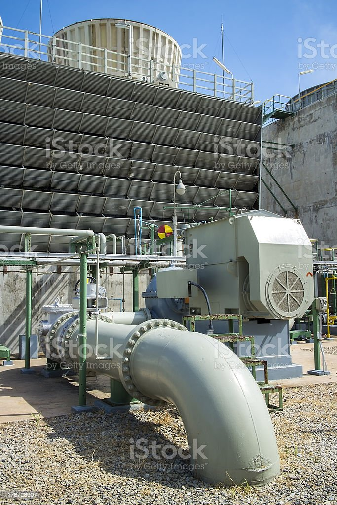 Pipe and Cooling Tower stock photo