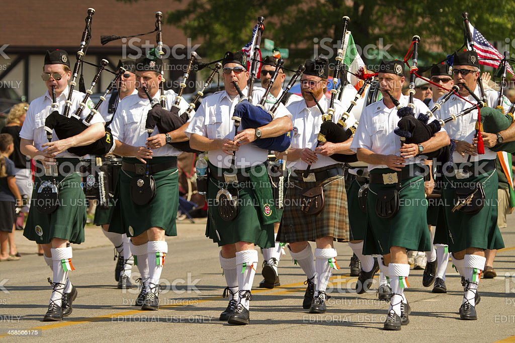 Pipe and Drum Corps Marching in Memorial Day Parade stock photo