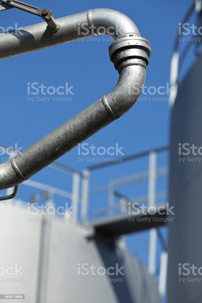 Pipe and Storage Tanks at Fuel Depot royalty-free stock photo