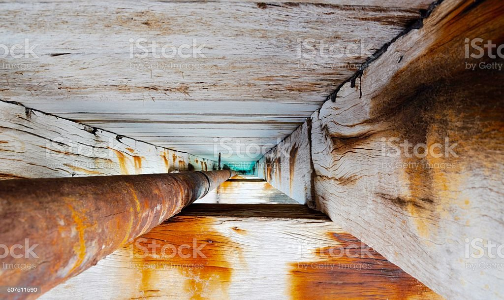 Pipe and Wood: Jetty Perspective stock photo