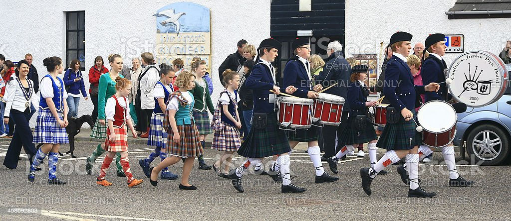 Pipe band and Highland Dancers celebrating Olympic Torch relay event stock photo