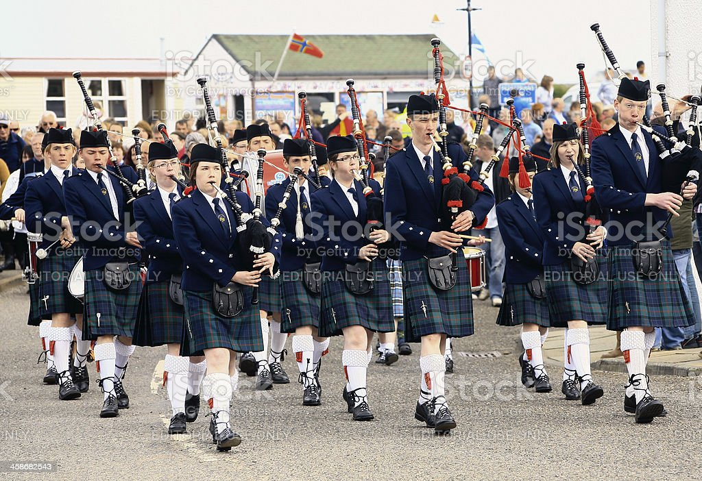 Pipe band celebrating London 2012 Olympic Torch relay event stock photo