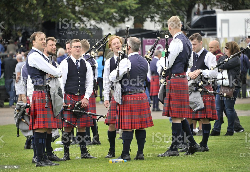 Pipe band in discussion at world pipe band championships stock photo