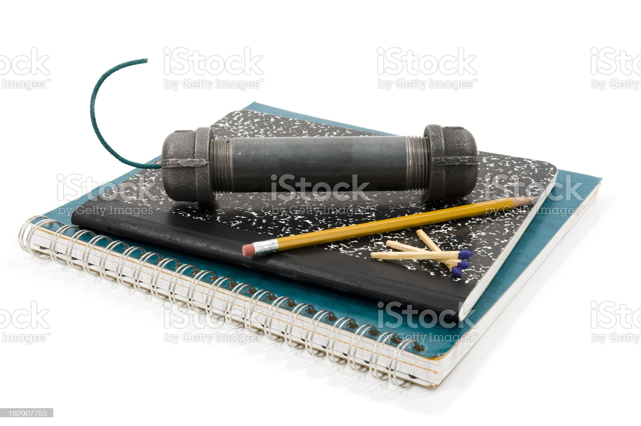 Pipe Bomb sitting on school notebooks royalty-free stock photo