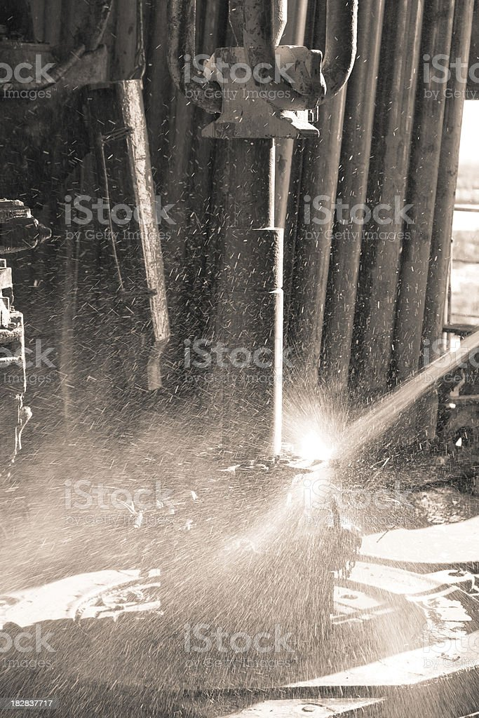 Pipe cleaning at derrick royalty-free stock photo