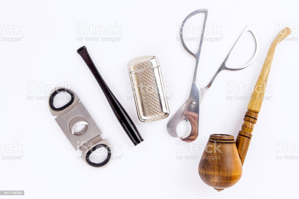 Pipe, lighter, cigarette holder and metal cutters stock photo