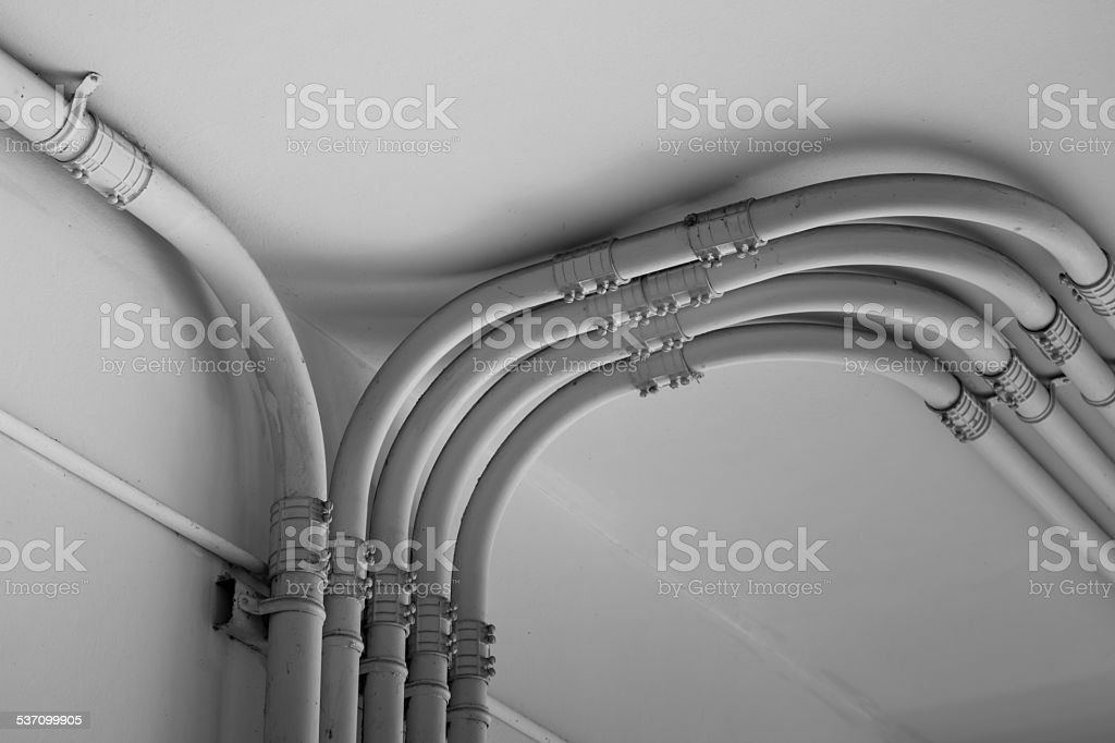Pipe of electricity line on cement  wall stock photo