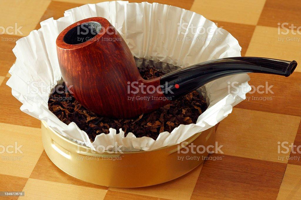 Pipe on tobacco box stock photo