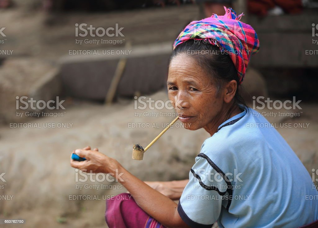 Pipe smoking woman-Akha tribe. Nam Ha area-Luang Namtha province-Laos. 3402 stock photo