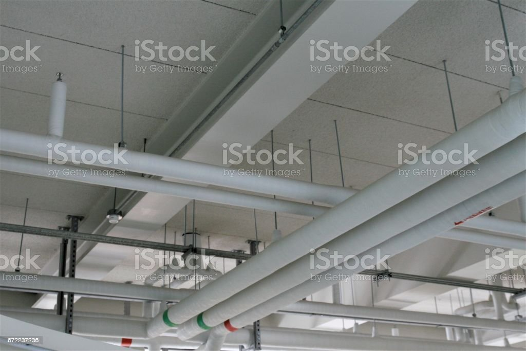 pipe system install with the concrete ceiling stock photo