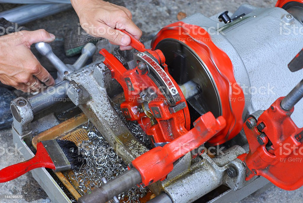 pipe threading machine stock photo