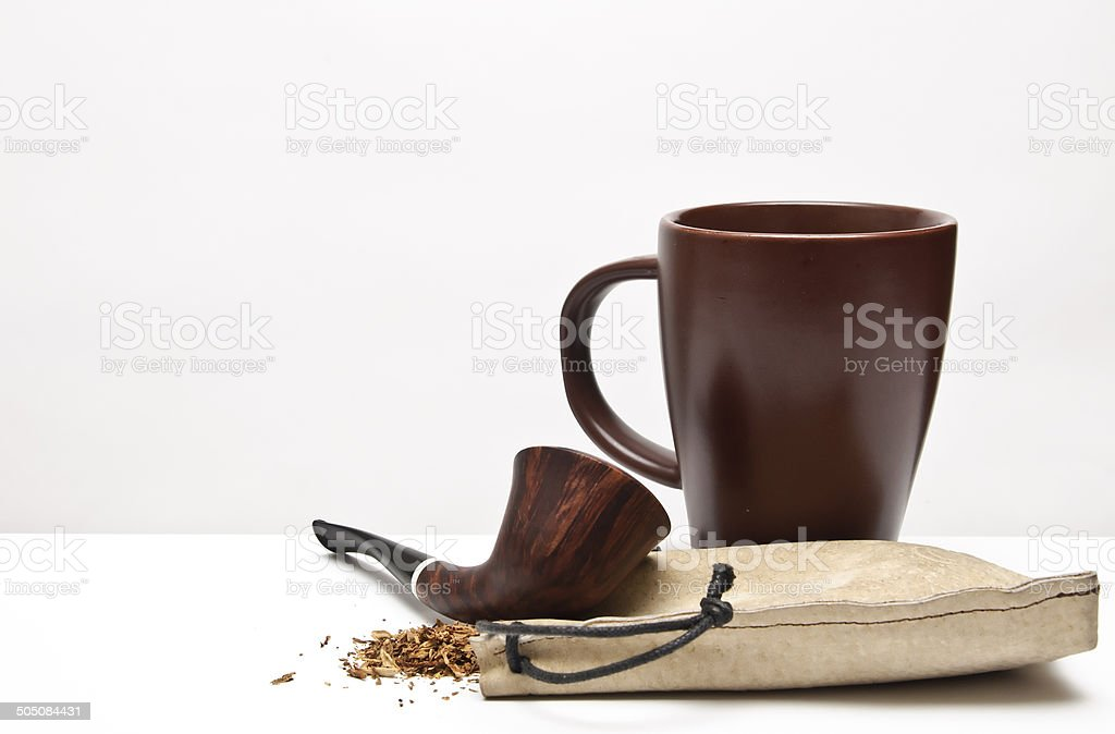 pipe tobacco and a glass background royalty-free stock photo