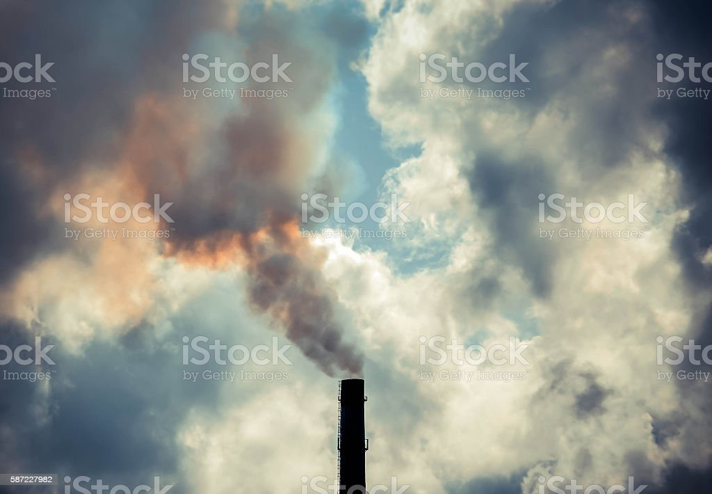 pipe with thick smoke and the sky, clouds stock photo