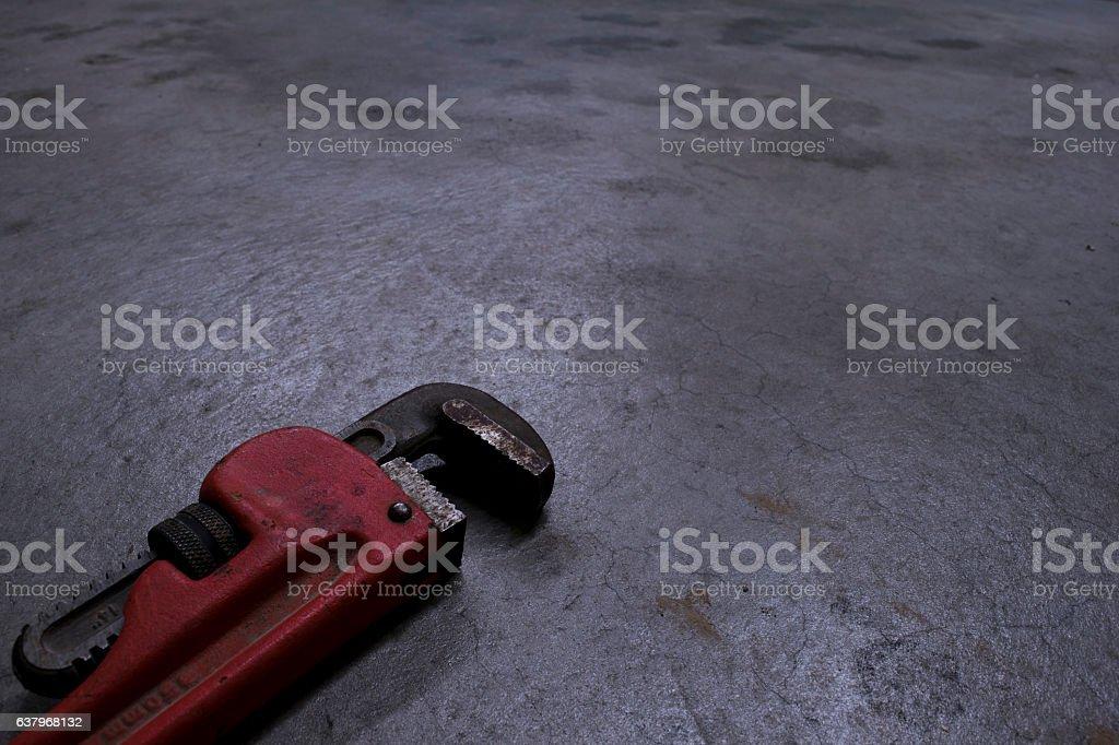 Pipe Wrench On Concrete Floor stock photo