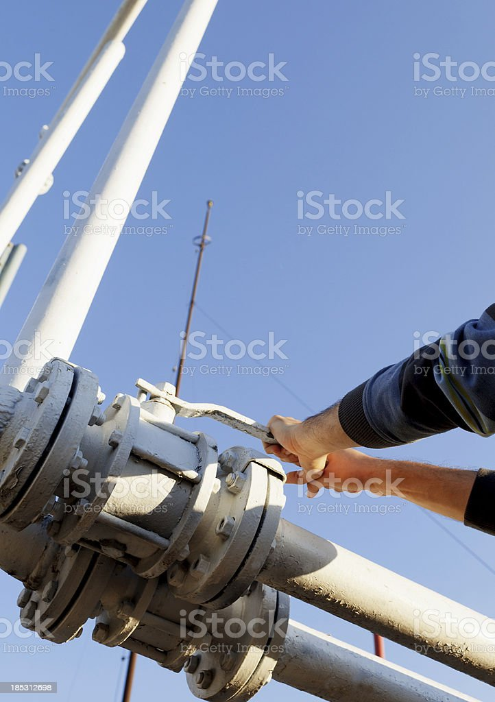 Pipeline and Hands on valve royalty-free stock photo