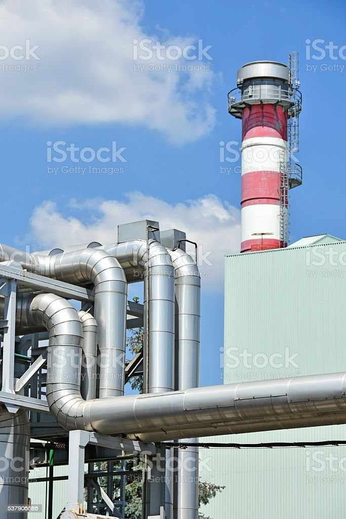 Pipeline and smoke stack of the power station stock photo