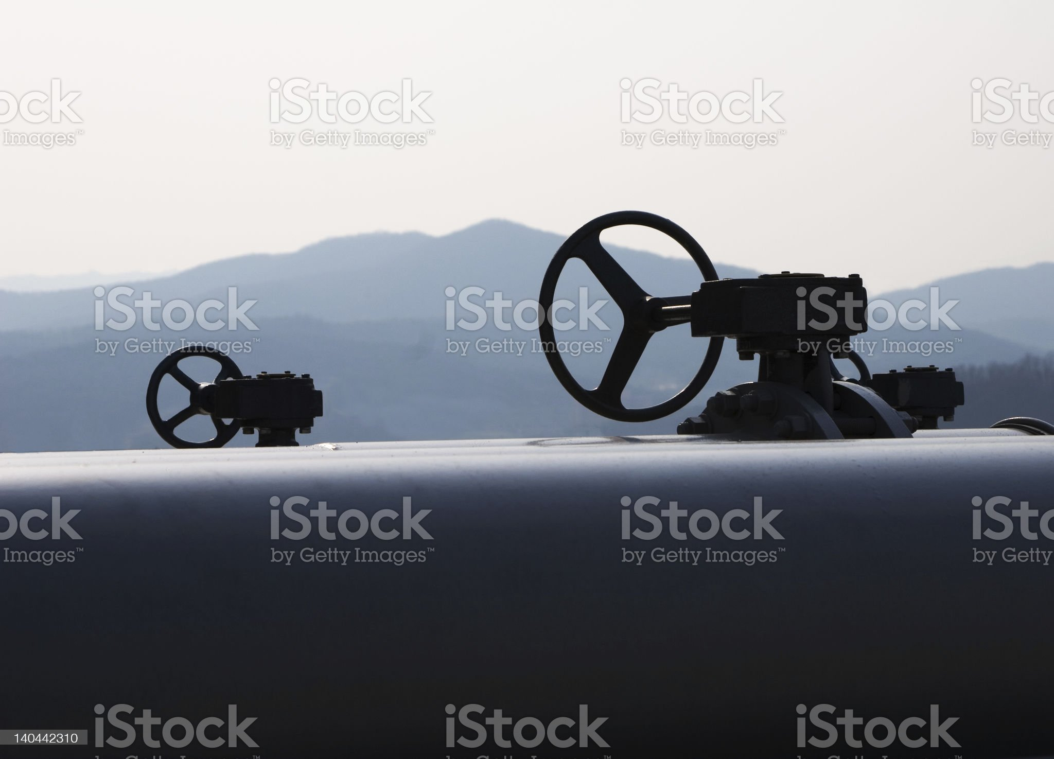Pipeline and valves over mountain landscape royalty-free stock photo