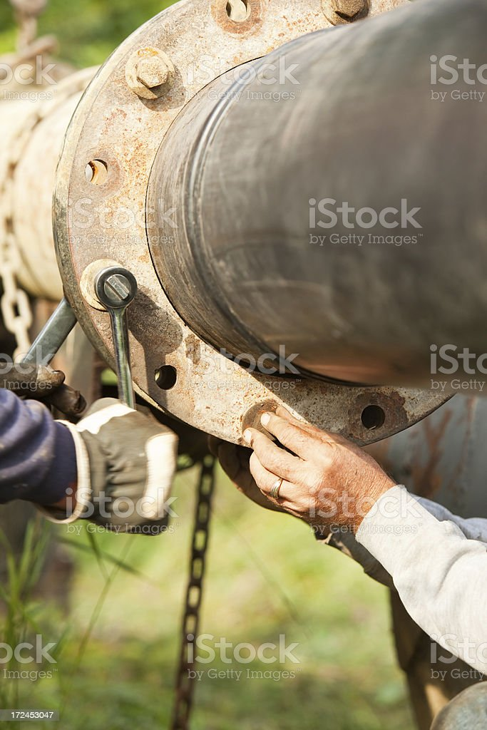 Pipeline Assembly with Wrench and Hand stock photo