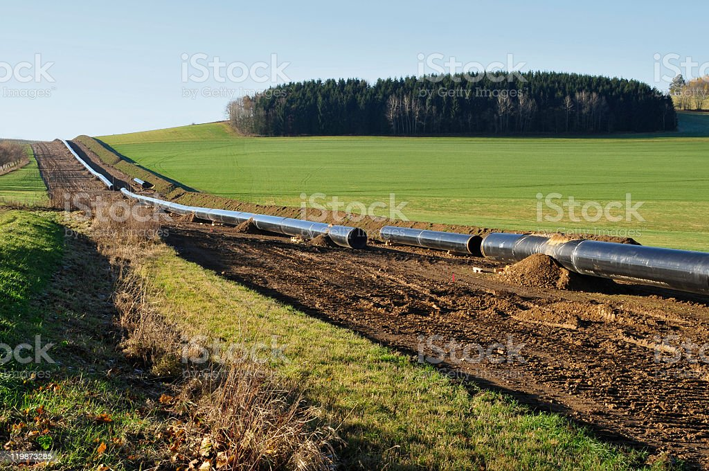 Pipeline construction in hilly landscape stock photo