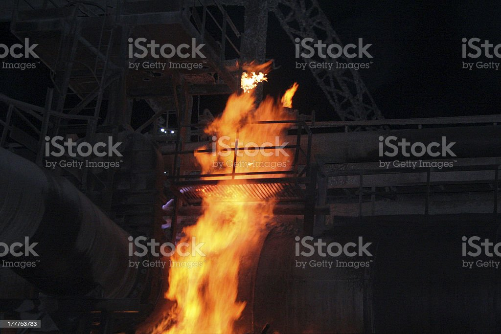 Pipeline fire and smokestack royalty-free stock photo
