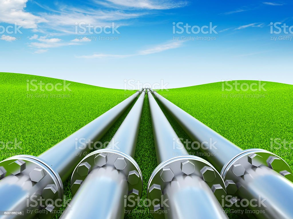 Pipeline on green grass stock photo