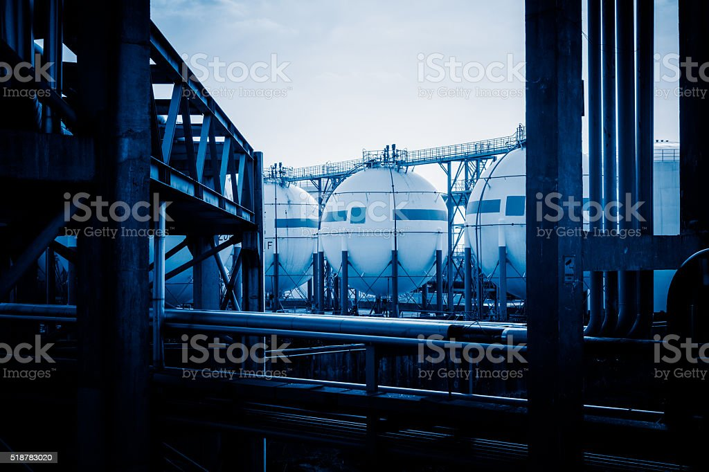 pipelines and oil tanks stock photo
